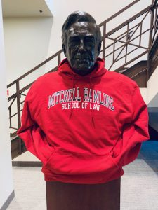 Statue of Warren Burger in a red Mitchell Hamline hoodie