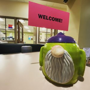 Ceramic gnome holding a welcome sign