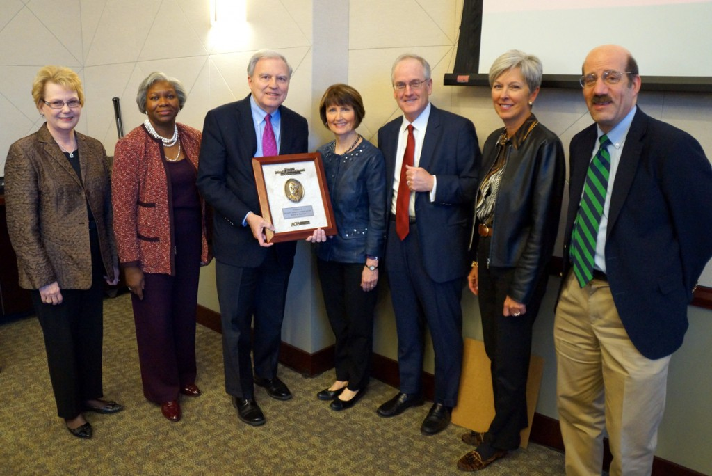 Leaders gathered Tuesday to accept the award from AGB Senior Consultant Sheila Stearns (center) included, from left, former Hamline University President Linda Hanson and current President Fayneese Miller, Hamline board chair Bob Klas Jr., Mitchell Hamline board chair Dan O'Keefe and vice chair Helen Meyer, and Mitchell Hamline President and Dean Mark Gordon.