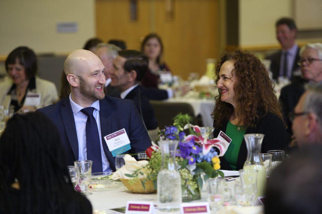 Nick Pouladian talks with Barbara Klas '91 at Mitchell Hamline's Scholarship Luncheon. (Photo: Rebecca Zenefski, By Rebecca Studios)